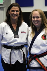 About Us Mrs. Arlington from Play It Safe and Sa Bom Nim Gilvey at AK Martial Arts & Fitness