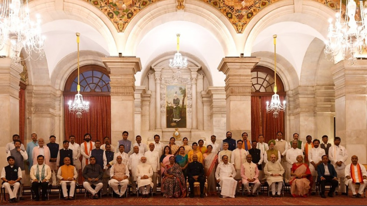 Prime Minister Narendra Modi with his renewed Cabinet on Wednesday