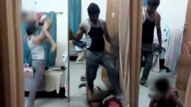 Still from the viral video of the father brutally thrashing his son