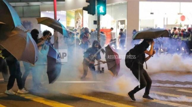 Hong Kong protesters vandalise subway station, storm mall