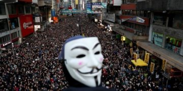 Peaceful Hong Kong march marred by fire outside court docket, police say