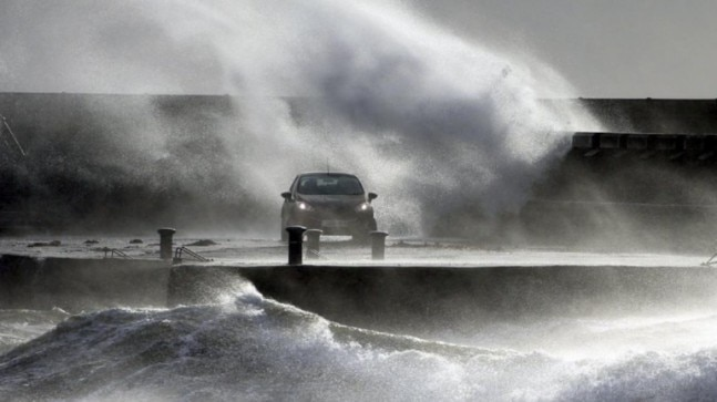 Hurricane-force winds pound UK and Europe, upend travel