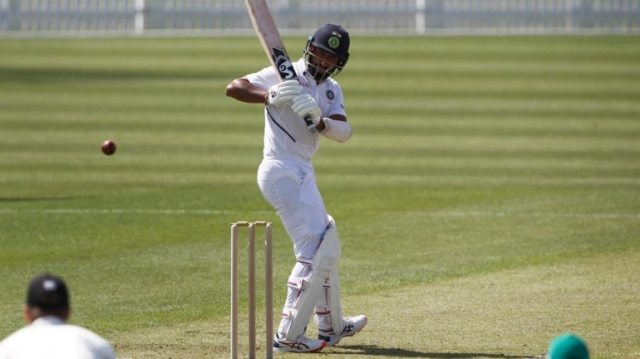 Cheteshwar Pujara scored a fighting fifty to pull India out of trouble in Hamilton