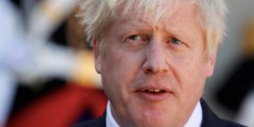 British PM Boris Johnson stable after second night in intensive care battling Covid-19