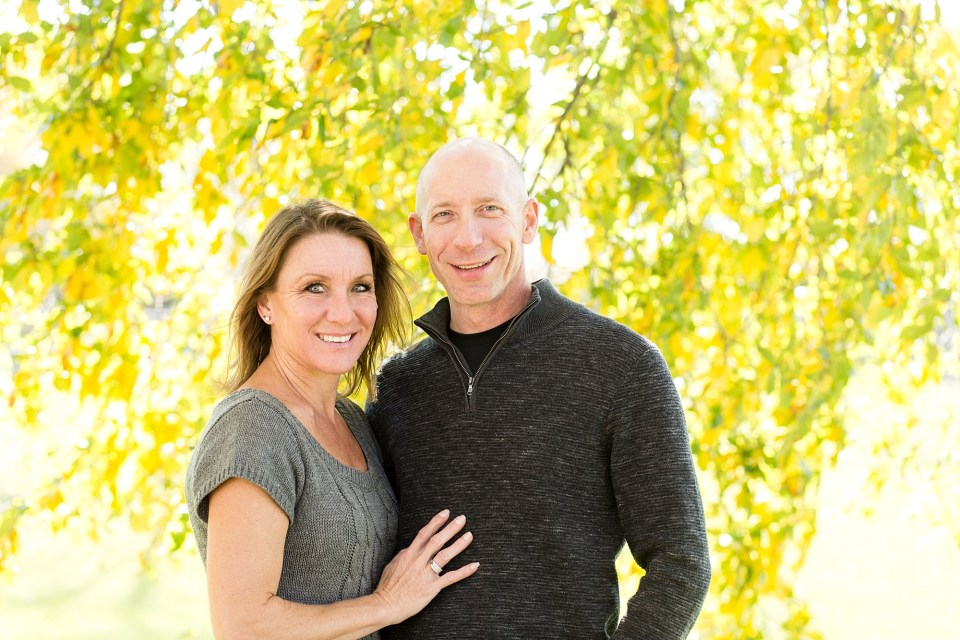 Couple in front of Yellow Leaves