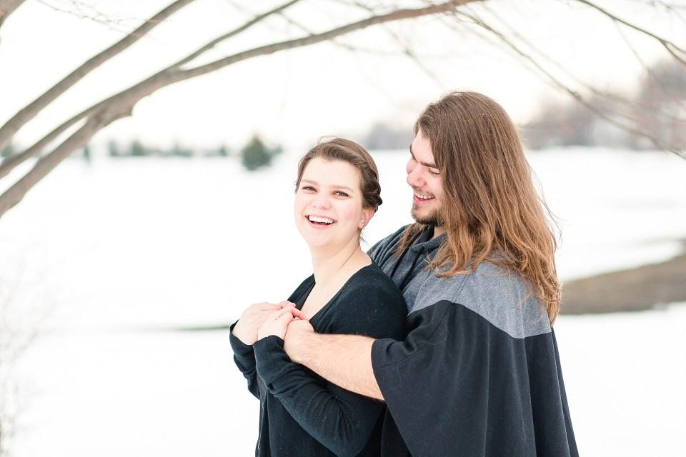 Smiling engagement photos in winter wonderland