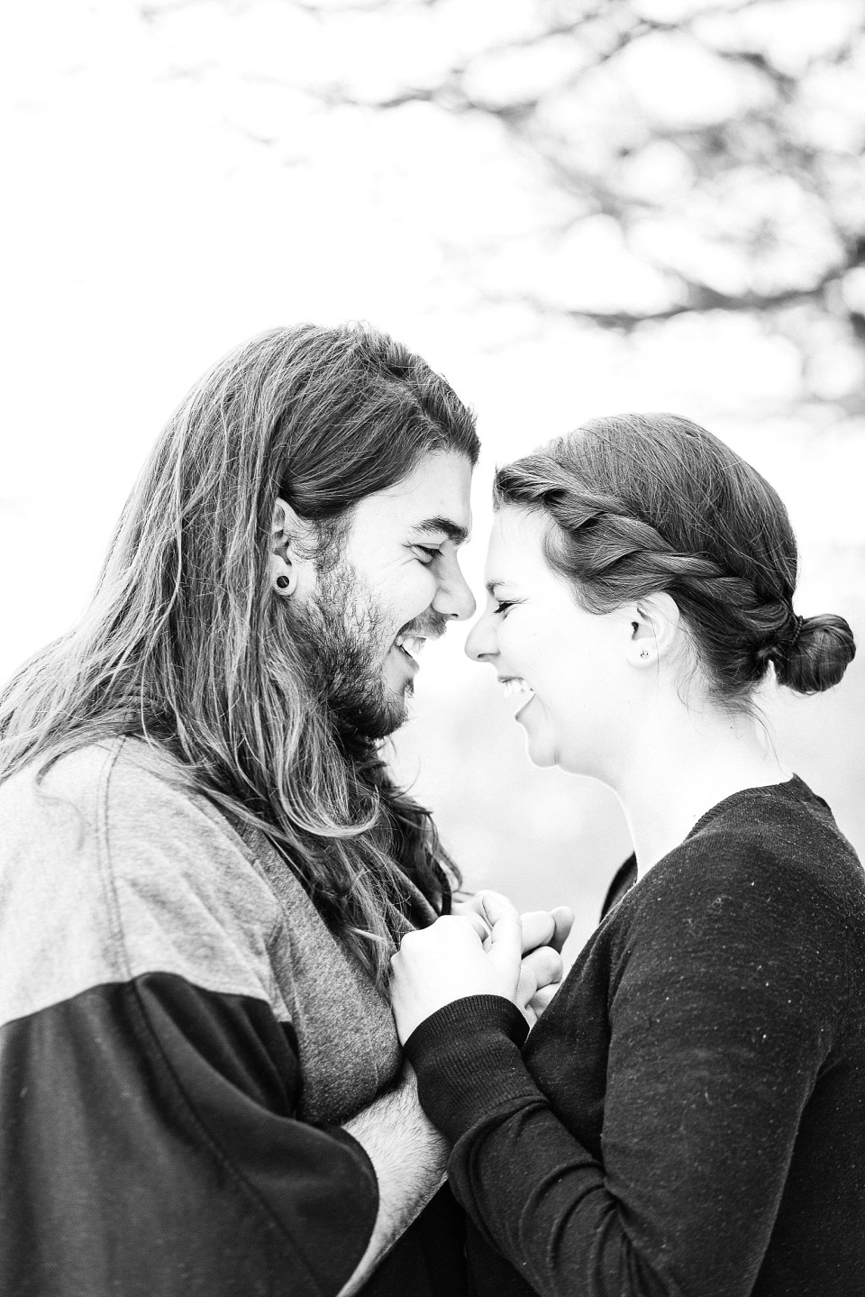 Laughing couple in black and white engagement photo