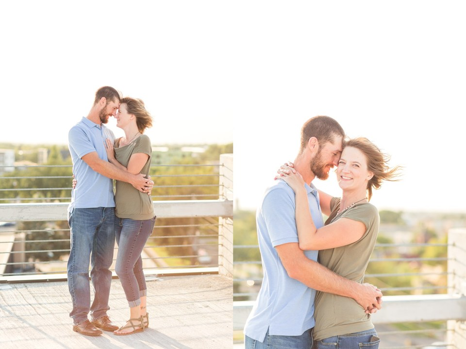 Engaged couple hold each other at the top of the Robert's Alley parking ramp in Downtown Fargo
