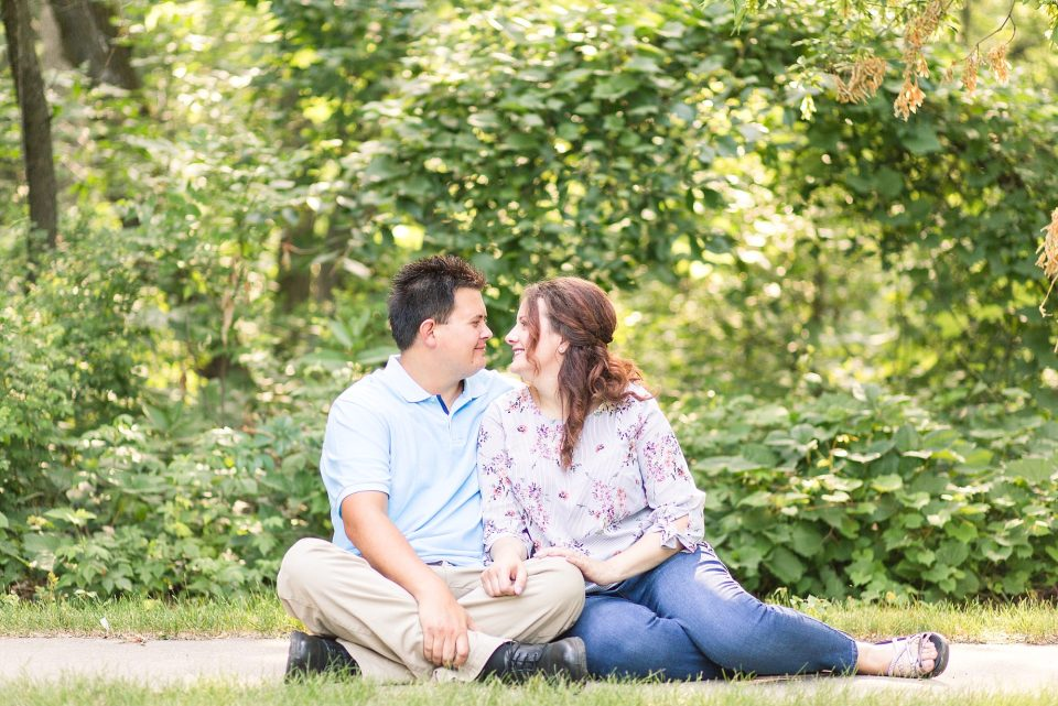 Engaged couple sit and smile at Buffalo State Park