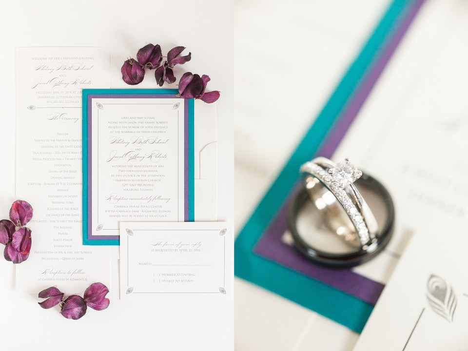 White gold wedding set rests against a purple and blue edge of a wedding invitation suite.