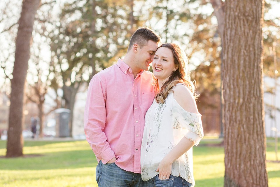 An engaged couple share a moment during their spring Island Park engagements session