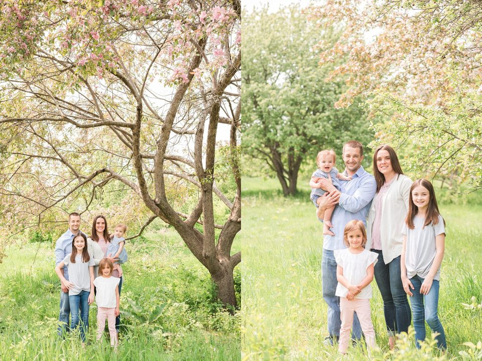 A Family of five smile while surrounded by spring blooms