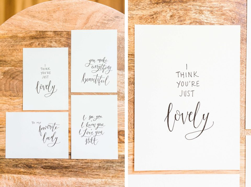 Hand written love notes lay on a wooden table.