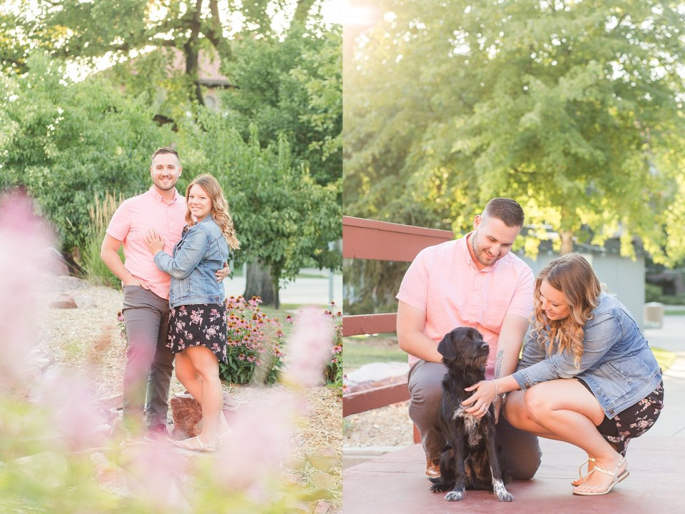 An engaged couple pet their puppy during their flower-filled engagement session at NDSU