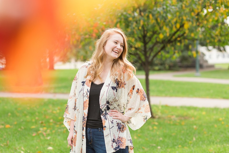Senior laughs over her shoulder during her fall senior photos