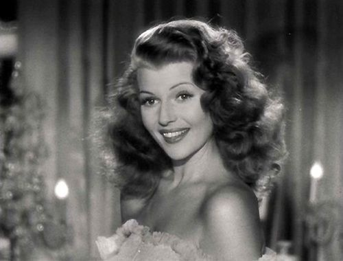 "Rita Hayworth sporting the ""Femme Fatal"" look"