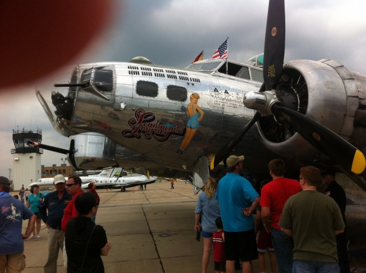The crowd stands around the B-17