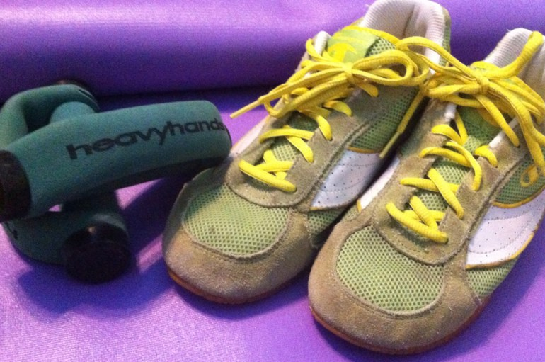 Exercise mat, dumb bells and sneakers