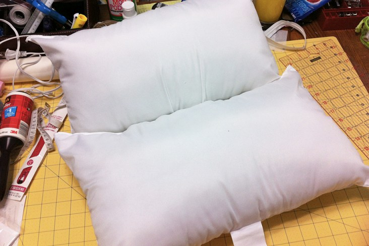 Standard pillow cut in half and sewed closed