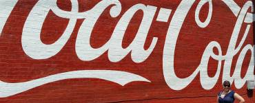 Posing in Modcloth nautical top paired with denim capris at the icon Coca-Cola sign on Route 66 in Sapulpa, Oklahoma.