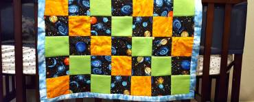 Learn to sew an easy baby block quilt using a standard nine block method for creating a basic quilt design.