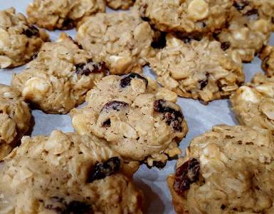 Recipe for Cranberry White Chocolate Oatmeal Cookies, a holiday twist on a soft chewy oatmeal cookie by adding dried cranberries and white chocolate chips.