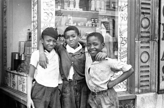 Children posing in front of a dime store in Black Bottom Detroit around <br>the 1930s or 40s. PHOTO: Walter P. Reuther Library Archives