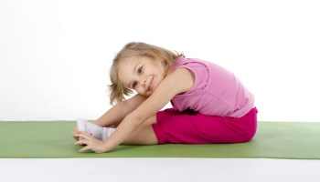 child doing gymnastics on a mat
