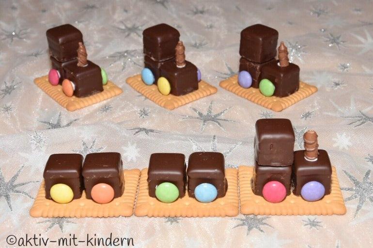 Weihnachtsplätzchen Kindergarten.Schnelle Weihnachtsplätzchen Kekskrippe Dominolok Kekskerze