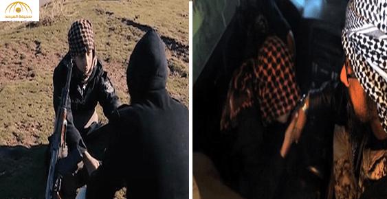 """بالفيديو والصور:صبي """"داعشي"""" يقبل يد والده قبل تفجير نفسه"""