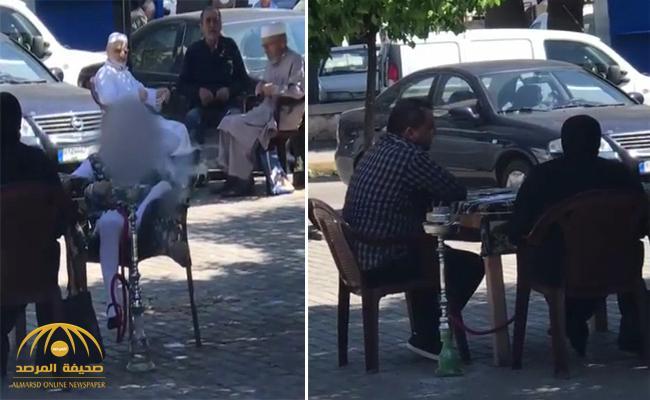 شاهد .. طفلة لبنانية تدخن الشيشة بجوار والديها