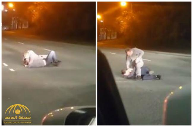 شاهد .. مشاجرة عنيفة بين شخصين في  منتصف طريق عام في إسبانيا