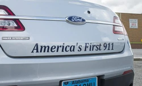 Police vehicles display first 911 call made in Haleyville, Al. Photo courtesy of Bernard Troncale.