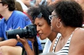 Abria Allen of Atlanta (who recently completed her college soccer career at Georgia Southern) takes photos at Legion Field as her mother, Rhea Allen, watches. (Solomon Crenshaw Jr./Alabama NewsCenter)