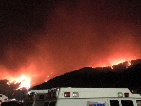Flames move along the mountainside. (Ethan Barrett/contributed)