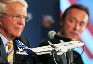 A model of an Airbus A320 is shown as Allan McArtor, Airbus Group, Inc. Chairman and CEO, left, and Fabrice Bregier, Airbus President and CEO, offer remarks during a press briefing Sunday, Sept. 13, 2015, in Mobile, Ala. (Mike Kittrell/Alabama NewsCenter)