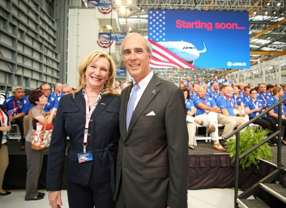 Gina Gregory, Mobile City Council president, left, and Mayor Sandy Stimpson attend the grand opening ceremony of Airbus U.S. Manufacturing Facility is held Monday, Sept. 14, 2015, in Mobile, Ala. (Mike Kittrell/Alabama NewsCenter)