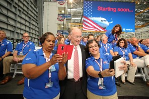 Airbus employees Chandra Smith, left, and Jennifer Ogle, right, take selfies with Alabama Gov. Ribert Bentley at he grand opening ceremony of Airbus U.S. Manufacturing Facility on Monday, Sept. 14, 2015, in Mobile, Ala. (Mike Kittrell/Alabama NewsCenter)