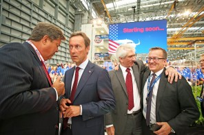 John L. Plueger, Air Lease Corporation President and CEO, left, confers with Fabrice Bregier, Airbus president and CEO, second from left, at the grand opening ceremony of Airbus U.S. Manufacturing Facility on Monday, Sept. 14, 2015, in Mobile, Ala. Barry Eccleston, Airbus Americas President, second from right, greets Olaf Lawrenz, A320 Program - Quality, right. (Mike Kittrell/Alabama NewsCenter)