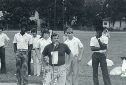 Coach Gerelds speaking to a pep rally at Woodlawn in 1974. (contributed)