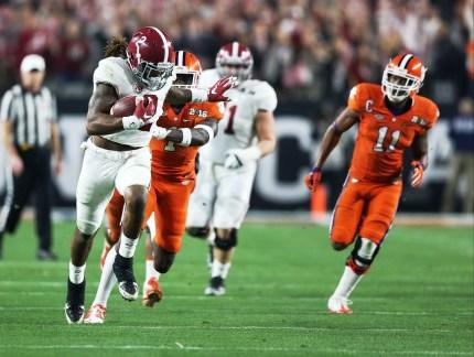 Crimson Tide running back Derrick Henry tries to shake a tackle. (Kent Gidley/UA Athletics)