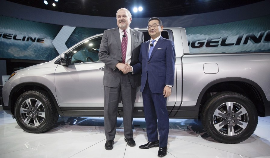 Takahiro Hachigo, president and chief executive officer of Honda Motor Co., right, and John Mendel, executive vice president of American Honda Motor Co., stand for a photograph following the debut of the 2017 Honda Ridgeline at the 2016 North American International Auto Show. (Daniel Acker/Bloomberg)