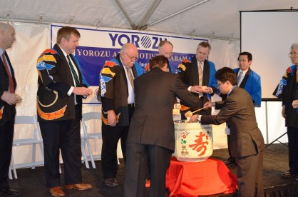 Officials participate in a sake barrel ceremony for Yorozu. (Michael Tomberlin/Alabama NewsCenter)
