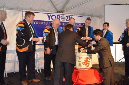 Officials participate in a sake barrel ceremony for Yorozu. (Michael Tomberlin/Alabama NewsCenter)