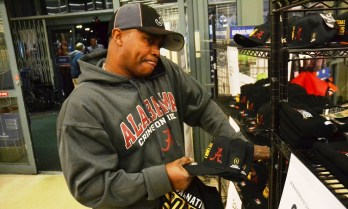 Romelle Tabb of Bessemer shops while talking on his phone. (Solomon Crenshaw Jr./Alabama NewsCenter)