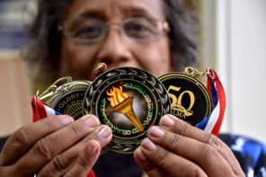 Dianne Harris proudly displays the medals she's received for her work as a civil rights activist.