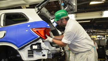 An employee at Honda's manufacturing plant in Talladega County works on a Pilot SUV. The plant turned out a record number of Pilots in 2017. (Contributed)