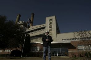 Plant Manager Riley Wells stands in front of Plant Greene County headquarters