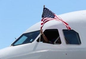 Test Pilot Bruce Macdonald flies a U.S. flag from the cockpit as the first Alabama-built Airbus A321 taxis to post-flight ceremony. (Mike Kittrell/Alabama NewsCenter)