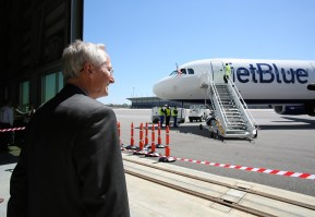 Airbus Final Assembly Line USA Vice President Ulrich Weber watches as the plane arrives for a post-flight ceremony. (Mike Kittrell/Alabama NewsCenter)